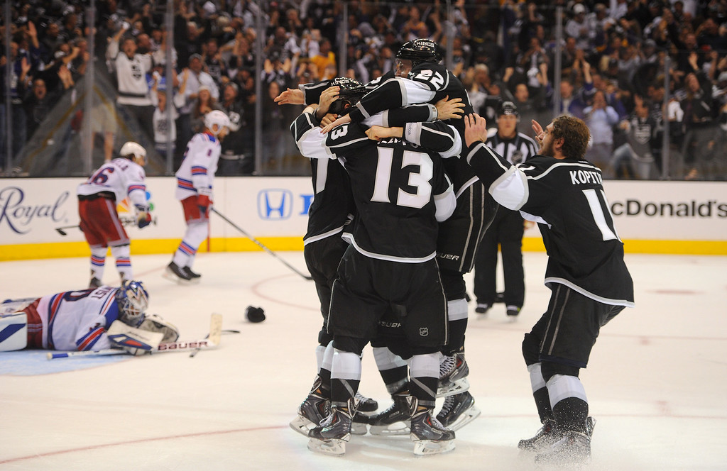 . Kings celebrate after beating the Rangers in double overtime to win the Stanley Cup, Friday, June 13, 2014, at Staples Center. (Photo by Michael Owen Baker/Los Angeles Daily News)