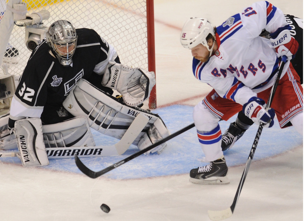 . Kings#32 Jonathan Quick stops a shot by Rangers#15 Derek Dorsett in the 2nd period. The Kings played the New York Rangers game 5 of the Stanley Cup Final at Staples Center in Los Angeles, CA. 6/13/2014(Photo by John McCoy Daily News)