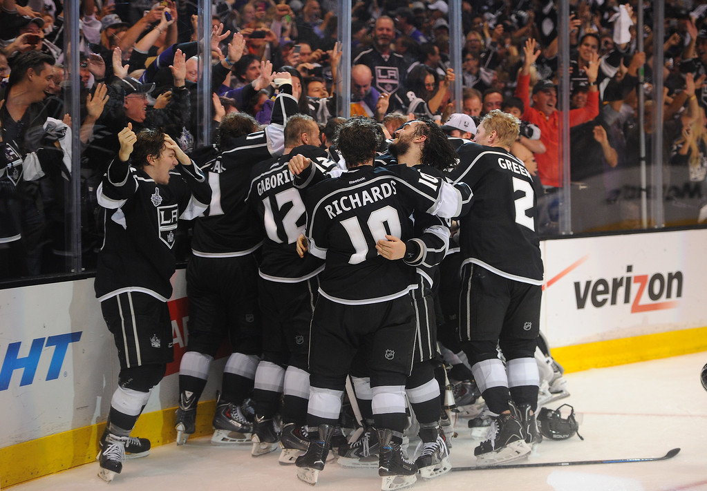 . The Kings celebrate after beating the Rangers in double overtime to win the Stanley Cup, Friday, June 13, 2014, at Staples Center. (Photo by Michael Owen Baker/Los Angeles Daily News)