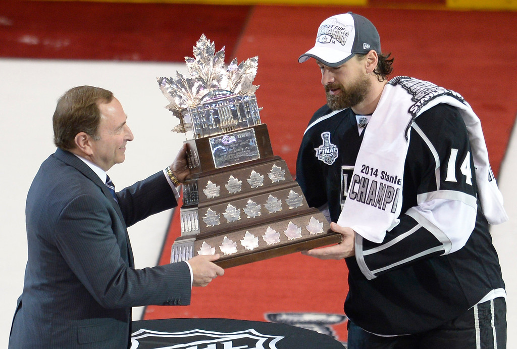 . Kings#14 Justin Williams takes the Conn Smyth trophy from the NHL Commissioner Gary Bettman. The Kings defeated the New York Rangers in the second overtime period to win the Stanley Cup at Staples Center in Los Angeles, CA. 6/13/2014(Photo by John McCoy Daily News)