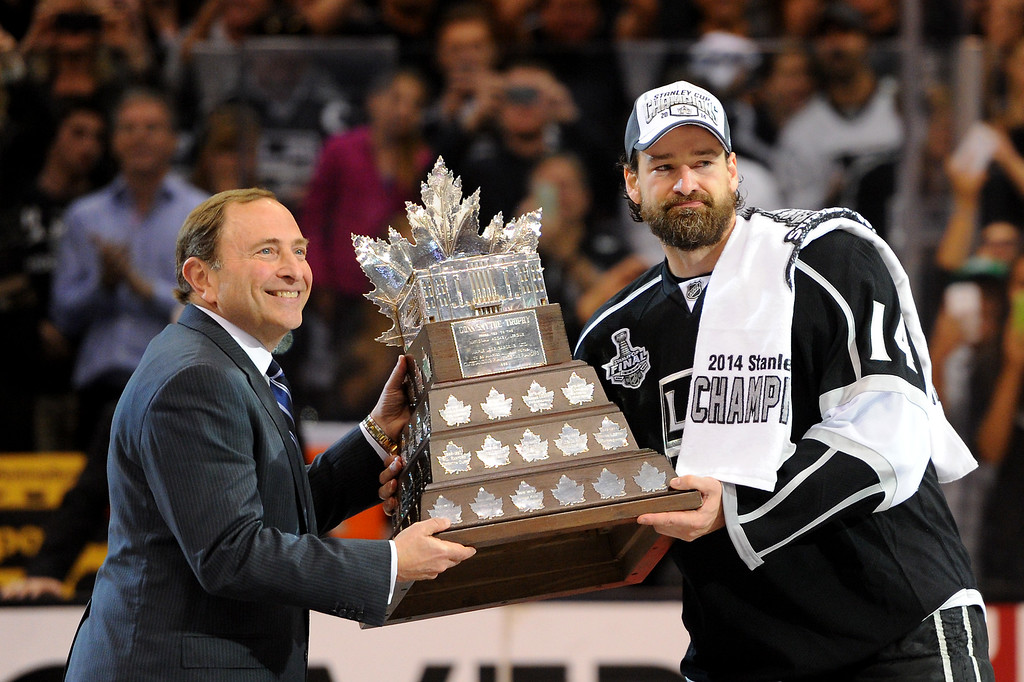 . NHL Commissioner Gary Bettman hands the Conn Smythe Award to the Kings\' Justin Williams after beating the Rangers in double-overtime, Friday, June 13, 2014, at Staples Center. (Photo by Michael Owen Baker/Los Angeles Daily News)