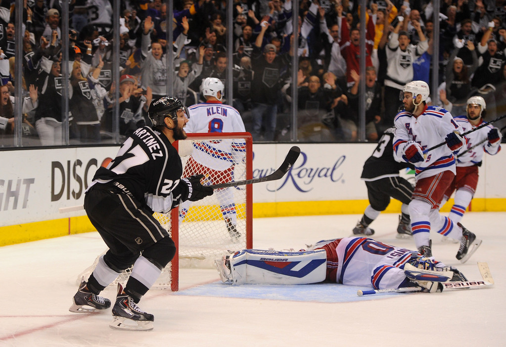 . The Kings\' Alec Martinez, left, reacts after scoring the winning goal in double overtime to beat the Rangers and win the Stanley Cup, Friday, June 13, 2014, at Staples Center. (Photo by Michael Owen Baker/Los Angeles Daily News)