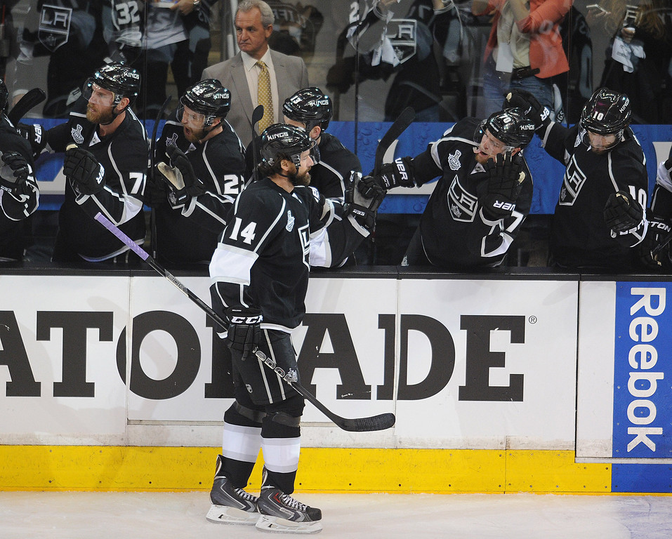 . Kings#14 Justin Williams is congratulated for his goal in the first period. The Kings played the New York Rangers game 5 of the Stanley Cup Final at Staples Center in Los Angeles, CA. 6/13/2014(Photo by John McCoy Daily News)