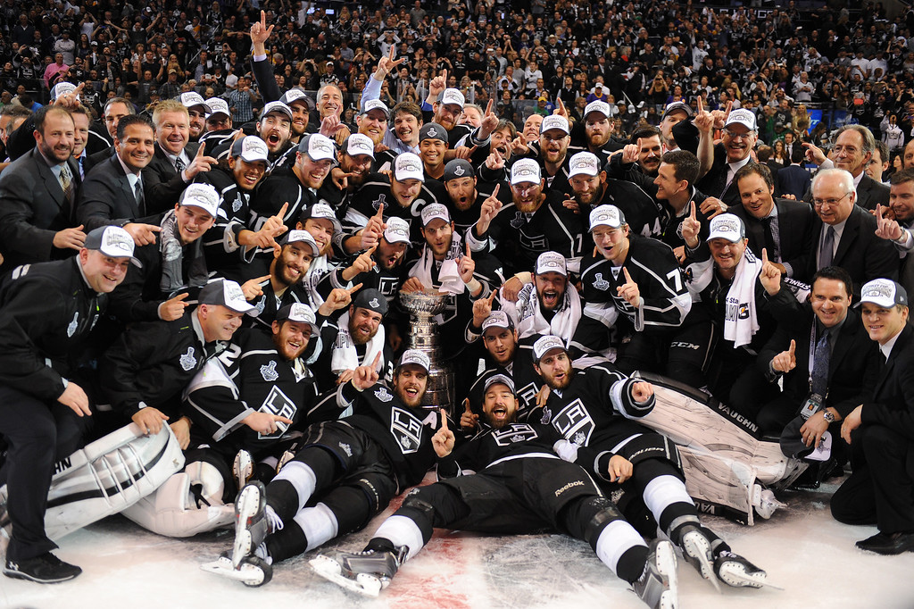 . Kings celebrate with the Stanley Cup after beating the Rangers 3-2 in double-overtime, Friday, June 13, 2014, at Staples Center. (Photo by Michael Owen Baker/Los Angeles Daily News)