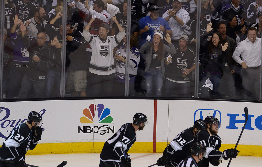 . Kings fans celebrate after Kings#12 Marian Gaborik made a goal in the 3rd period that sent the game into overtime. The Kings played the New York Rangers game 5 of the Stanley Cup Final at Staples Center in Los Angeles, CA. 6/13/2014(Photo by John McCoy Daily News)