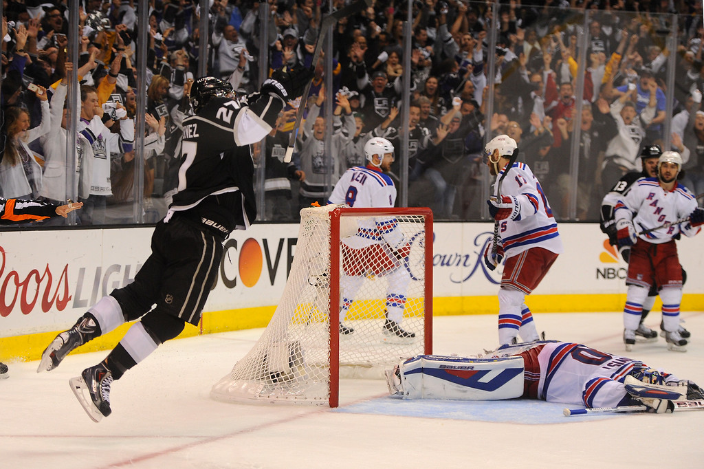 . The Kings\' Alec Martinez, left, celebrates after scoring the winning goal in double-overtime to beat the Rangers and win the Stanley Cup, Friday, June 13, 2014, at Staples Center. (Photo by Michael Owen Baker/Los Angeles Daily News)