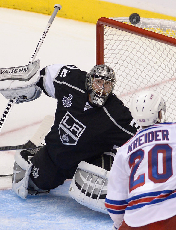 . Kings#32 Jonathan Quick deflects a shot from Rangers#20 Chris Kreider in the second overtime. The Kings defeated the New York Rangers in the second overtime period to win the Stanley Cup at Staples Center in Los Angeles, CA. 6/13/2014(Photo by John McCoy Daily News)