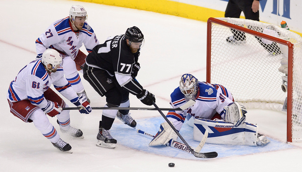 . Kings#77 Jeff Carter can not get the puck past Rangers#30 Henrik Lundqvist in the first overtime period. The Kings played the New York Rangers game 5 of the Stanley Cup Final at Staples Center in Los Angeles, CA. 6/13/2014(Photo by John McCoy Daily News)