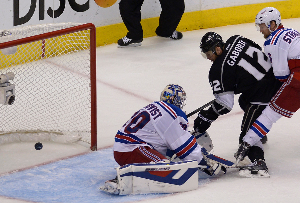 . Kings#12 Marian Gaborik shoots the puck past Rangers#30 Henrik Lundqvist in the 3rd period to send the game into overtime. The Kings played the New York Rangers game 5 of the Stanley Cup Final at Staples Center in Los Angeles, CA. 6/13/2014(Photo by John McCoy Daily News)