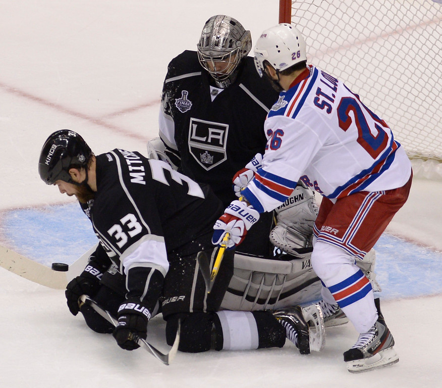 . Kings#33 Willie Mitchell and Kings#32 Jonathan Quick stop a puck by Rangers#26 Martin St. Louis in the 3rd period. The Kings played the New York Rangers game 5 of the Stanley Cup Final at Staples Center in Los Angeles, CA. 6/13/2014(Photo by John McCoy Daily News)