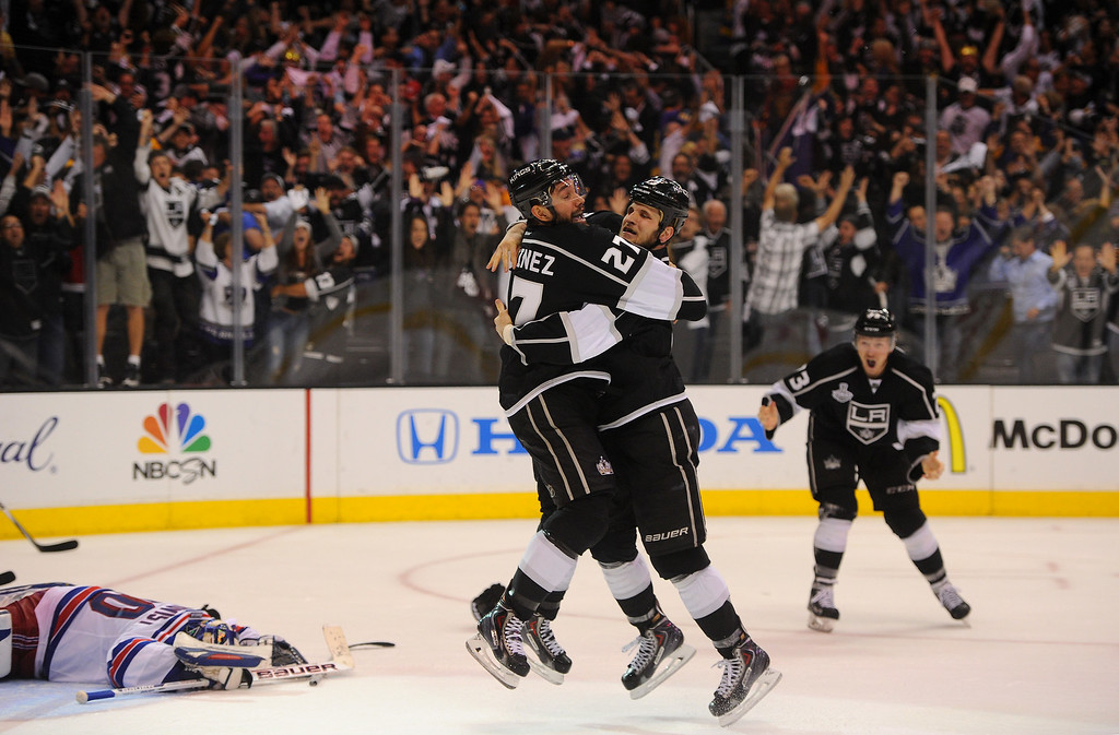 . The Kings\' Alec Martinez, left, celebrates with Kyle Clifford after scoring the winning goal in double overtime to beat the Rangers and win the Stanley Cup, Friday, June 13, 2014, at Staples Center. (Photo by Michael Owen Baker/Los Angeles Daily News)