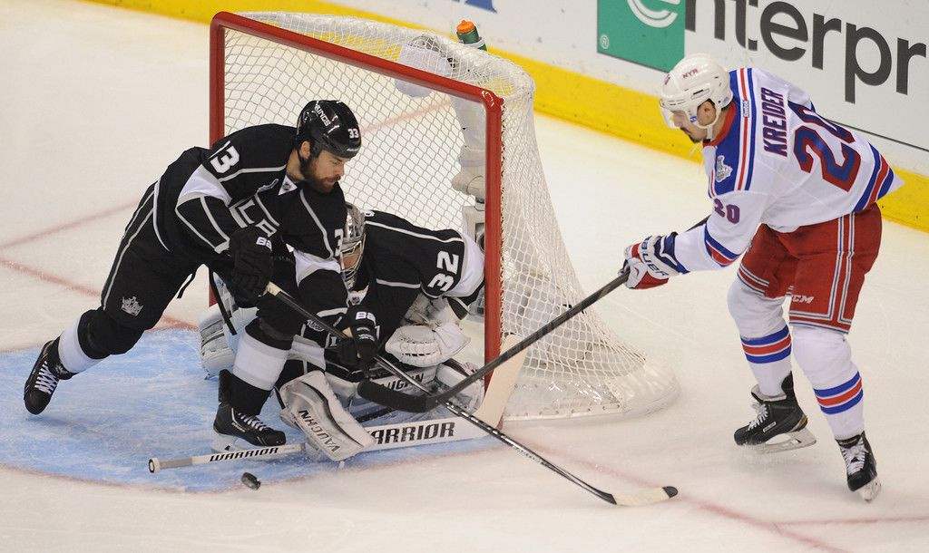. Kings#13 Kyle Clifford and Kings#32 Jonathan Quick stop a shot by Rangers#20 Chris Kreider in the first period. The Kings played the New York Rangers game 5 of the Stanley Cup Final at Staples Center in Los Angeles, CA. 6/13/2014(Photo by John McCoy Daily News)