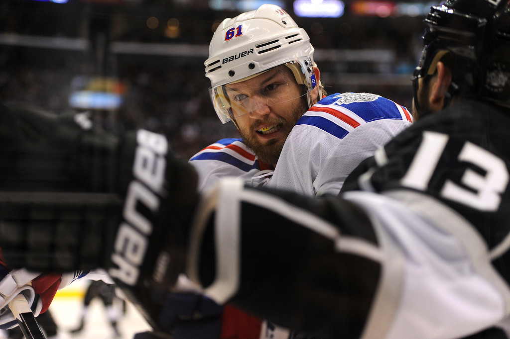 . The Rangers\' Rick Nash checks the Kings\' Kyle Clifford, Friday, June 13, 2014, at Staples Center. (Photo by Michael Owen Baker/Los Angeles Daily News)