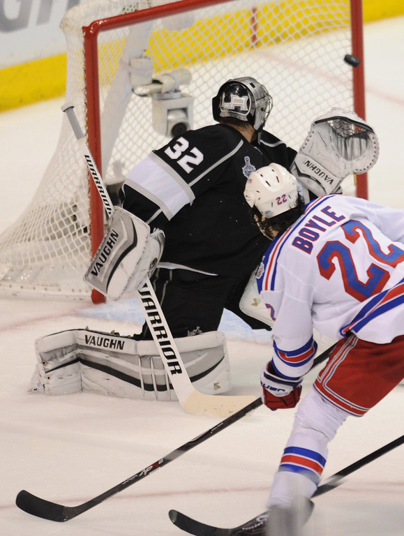 . Rangers#22 Brian Boyle shoots the puck off the inside of the goal post, past Kings#32 Jonathan Quick for a score in the 2nd period. The Kings played the New York Rangers game 5 of the Stanley Cup Final at Staples Center in Los Angeles, CA. 6/13/2014(Photo by John McCoy Daily News)