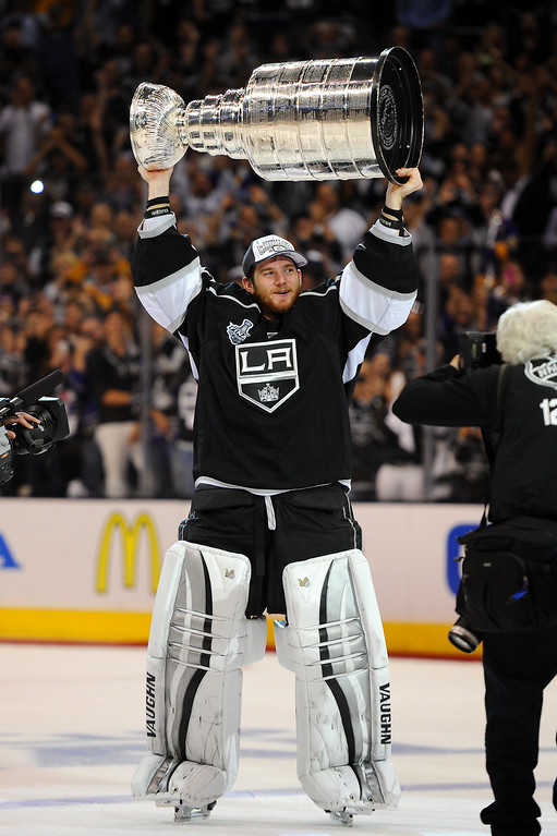 . The Kings\' Jonathan Quick skates with the Stanley Cup after beating the Rangers in double-overtime, Friday, June 13, 2014, at Staples Center. (Photo by Michael Owen Baker/Los Angeles Daily News)