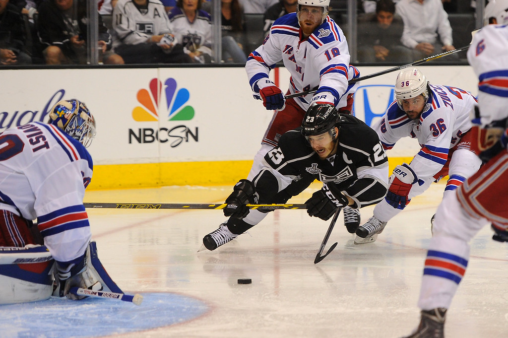 . The Kings\' Dustin Brown is tripped up near the goal in the second period against the Rangers in game five of the Stanley Cup Final, Friday, June 13, 2014, at Staples Center. (Photo by Michael Owen Baker/Los Angeles Daily News)
