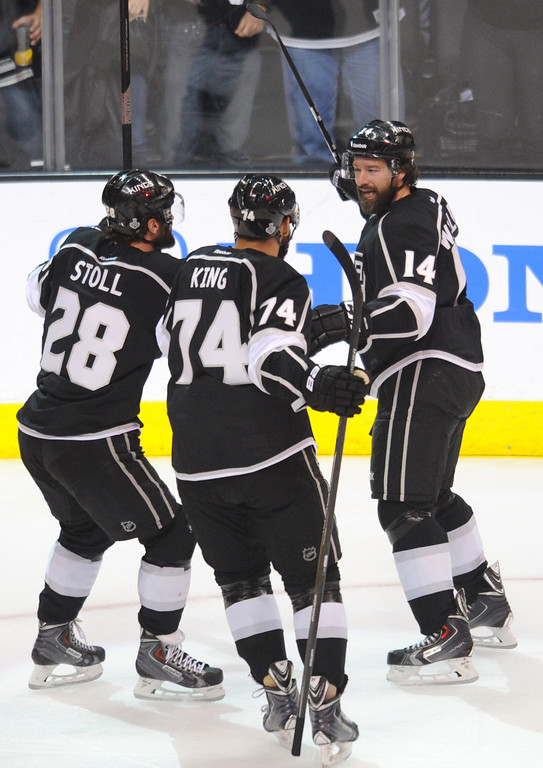 . Kings#28 Jarret Stoll and Kings#74 Dwight King congratulate Kings#14 Justin Williams on his goal in the first period. The Kings played the New York Rangers game 5 of the Stanley Cup Final at Staples Center in Los Angeles, CA. 6/13/2014(Photo by John McCoy Daily News)