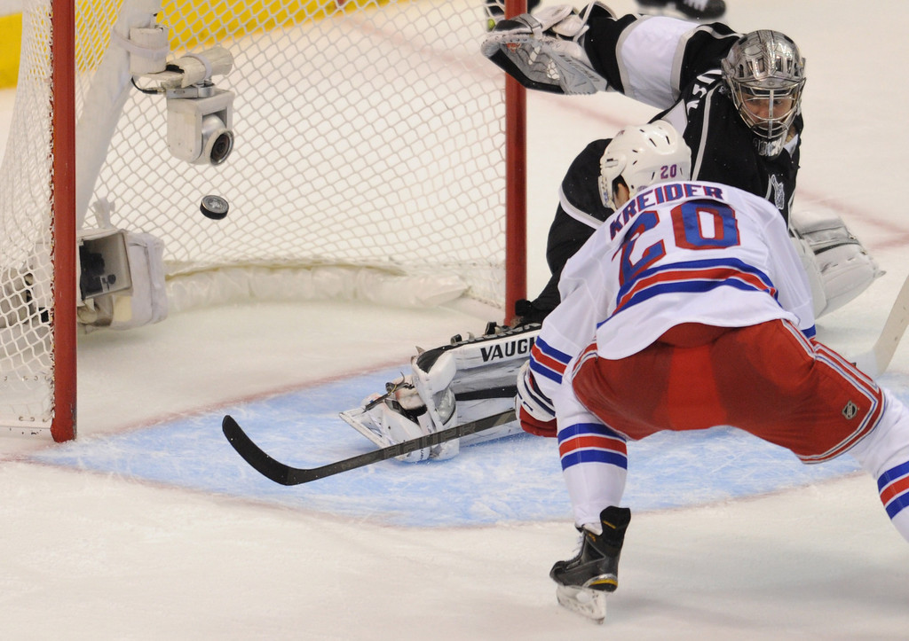 . Rangers#20 Chris Kreider shoots the puck past Kings#32 Jonathan Quick on a short handed goal in the 2nd period. The Kings played the New York Rangers game 5 of the Stanley Cup Final at Staples Center in Los Angeles, CA. 6/13/2014(Photo by John McCoy Daily News)