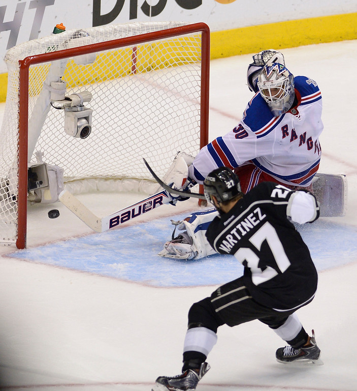 . Kings#27 Alec Martinez scores the winning goal against Rangers#30 Henrik Lundqvist. The Kings defeated the New York Rangers in the second overtime period to win the Stanley Cup at Staples Center in Los Angeles, CA. 6/13/2014(Photo by John McCoy Daily News)