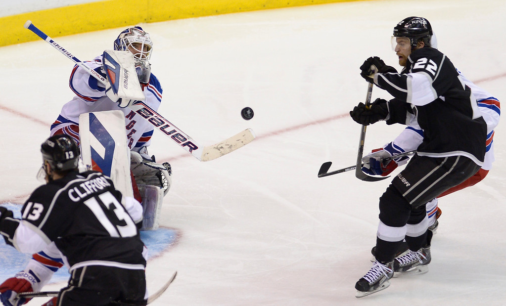 . Rangers#30 Henrik Lundqvist stops a puck by Kings#22 Trevor Lewis in the 2nd overtime period. The Kings defeated the New York Rangers in the second overtime period to win the Stanley Cup at Staples Center in Los Angeles, CA. 6/13/2014(Photo by John McCoy Daily News)
