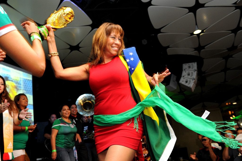 . Soccer fans dance during halftime at the Mexico vs Brazil World Cup viewing party at the Conga Room at L.A. Live, Tuesday, June 17, 2014. (Photo by Michael Owen Baker/Los Angeles Daily News)