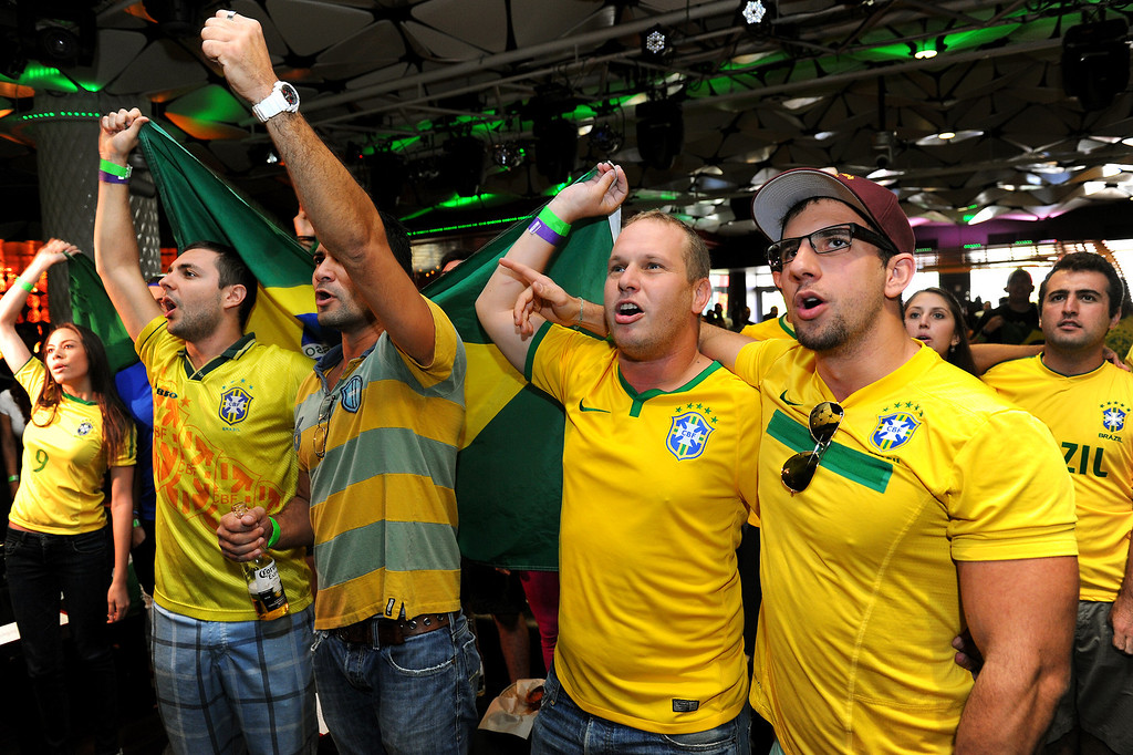 . Brazil soccer fans sing the Brazil national anthem at the Mexico vs Brazil viewing party at the Conga Room at L.A. Live, Tuesday, June 17, 2014. (Photo by Michael Owen Baker/Los Angeles Daily News)