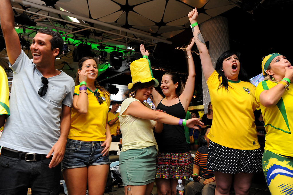 . Brazil soccer fans cheer at the Mexico vs Brazil viewing party at the Conga Room at L.A. Live, Tuesday, June 17, 2014. (Photo by Michael Owen Baker/Los Angeles Daily News)