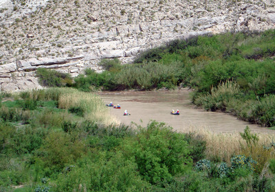 CANOEING THE RIO GRANDE You could hear these guys whooping it up way up where we were. They were movin' on.