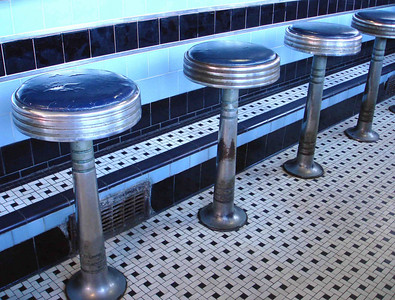 COUNTER STOOLS You can see what I meant by well-worn in this nice angled shot of the diner's counter stools. Lots of folks have sat on these stools. I wonder who?