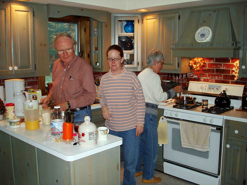 BREAKFAST IN THE MAKING<br /> Ever the tireless hostess, Lisa helps her mom and dad -- John and Susan -- in preparation for the morning feast. There's just no stopping this girl!