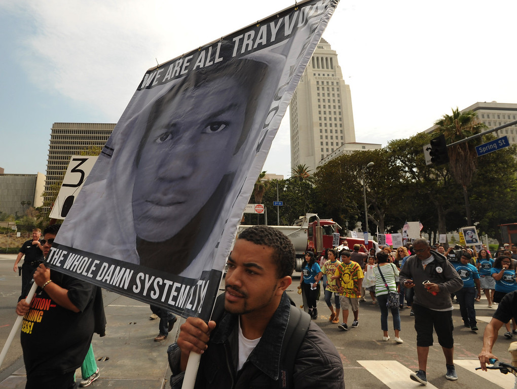 """. Protestors march down Spring street near City Hall. Earlier, they gathered in front of the Los Angeles Federal Court Building as part of what the National Action Network have called for a \""""Day of Solidarity.\"""" After the gathering, people splintered off in a march that was headed for Leimert Park. Elsewhere, demonstrations include protests and vigils on the front steps of federal court buildings nationwide. Los Angeles, CA. 7/20/2013(John McCoy/LA Daily News)"""
