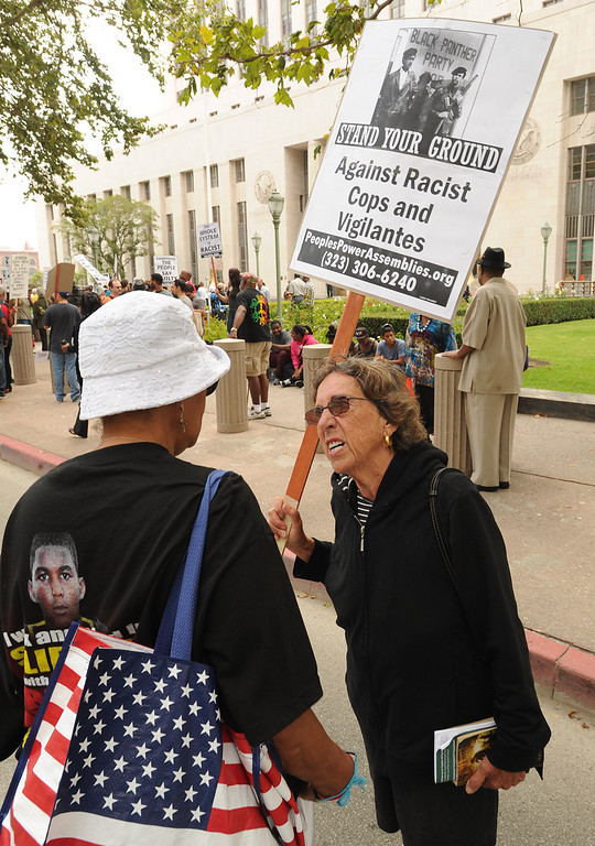 """. Protestors gathered in front of the Los Angeles Federal Court Building as part of what the National Action Network have called for a \""""Day of Solidarity.\"""" After the gathering, people splintered off in a march that was headed for Leimert Park. Elsewhere, demonstrations include protests and vigils on the front steps of federal court buildings nationwide. Los Angeles, CA. 7/20/2013(John McCoy/LA Daily News)"""