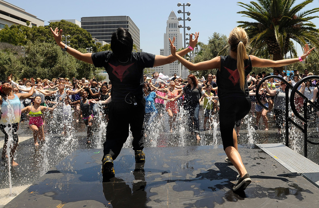 """. Thousands danced together for National Dance Day at downtown Los Angeles� Grand Park, home to the West coast�s flagship celebration.  Park visitors joined \""""So You Think You Can Dance�s\"""" Nigel Lythgoe, Adam Shankman, Napoleon and Tabitha Dumo and other popular dance celebrities as part of a nationwide grassroots initiative that promotes the joy and benefits of dance for everyone. 7/27/2013Los Angeles California, photos courtesy The Music Center"""