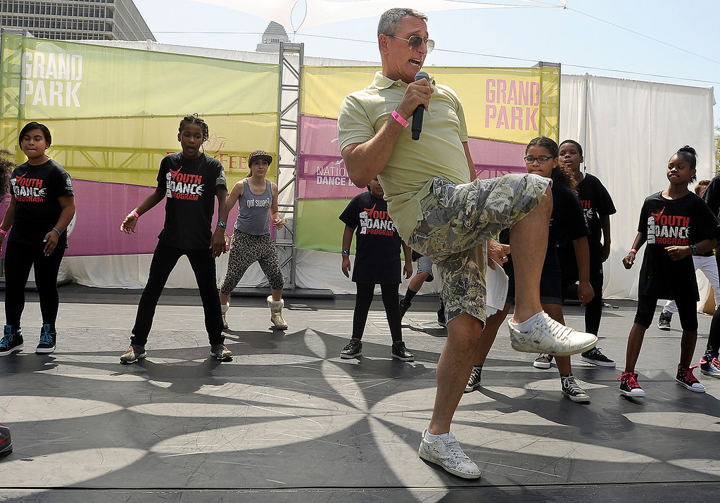 """. Adam Shankman dances with kids. Thousands danced together for National Dance Day at downtown Los Angeles� Grand Park, home to the West coast�s flagship celebration.  Park visitors joined \""""So You Think You Can Dance�s\"""" Nigel Lythgoe, Shankman, Napoleon and Tabitha Dumo and other popular dance celebrities as part of a nationwide grassroots initiative that promotes the joy and benefits of dance for everyone. 7/27/2013Los Angeles California, photos courtesy The Music Center"""