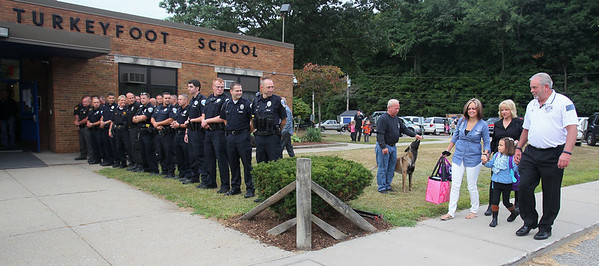082815 Akron police escort girl to school