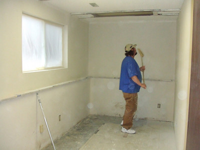 """This is the room behind the garage that the present owner said """"you could use it as a 5th bedroom"""".  Look how small it is.  It would be a good place for storage, but other than that it really is not good for much.  I have a feeling that the wall to the right will be knocked down to make the garage larger."""