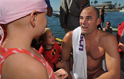 9/28/13 - Curtis Bowman chats with Sydney Waldrop at the dock where he and three other firefighters, two lifeguards, finished their relay swim from Catalina Island to Long Beach. At the finish they were greeted by those they raised funds for,  Jonathan Jaques Children's Cancer Center patients and families. (Photo by Brittany Murray/Press Telegram)