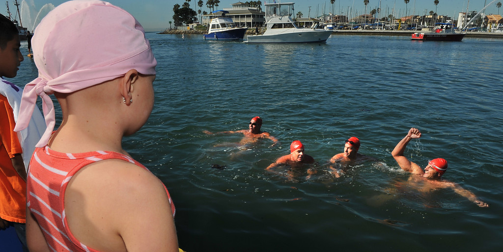 . 9/28/13 - Sydney Waldrop, 8, watches from the dock as four firefighters and two lifeguards, led by Long Beach Fire Engineer Curtis Bowman, participated in a relay swim from Catalina Island to Long Beach. At the finish they were greeted by those they raised funds for,  Jonathan Jaques Children�s Cancer Center patients and families. (Photo by Brittany Murray/Press Telegram)