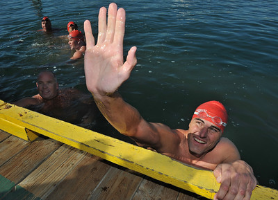 9/28/13 - Curtis Bowman reaches up for a hi-five from Sydney Waldrop at the dock where he and three other firefighters and two lifeguards, finished their relay swim from Catalina Island to Long Beach. At the finish they were greeted by those they raised funds for,  Jonathan Jaques Children's Cancer Center patients and families. (Photo by Brittany Murray/Press Telegram)