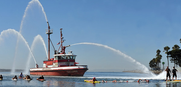 9/28/13 - Four firefighters and two lifeguards, led by Long Beach Fire Engineer Curtis Bowman, participated in a relay swim from Catalina Island to Long Beach. At the finish they were greeted by those they raised funds for,  Jonathan Jaques Children's Cancer Center patients and families. (Photo by Brittany Murray/Press Telegram)
