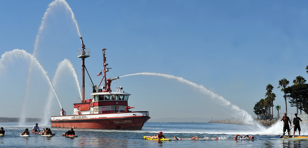 . 9/28/13 - Four firefighters and two lifeguards, led by Long Beach Fire Engineer Curtis Bowman, participated in a relay swim from Catalina Island to Long Beach. At the finish they were greeted by those they raised funds for,  Jonathan Jaques Children�s Cancer Center patients and families. (Photo by Brittany Murray/Press Telegram)