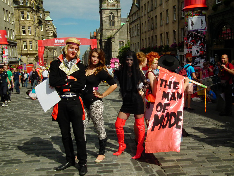 Performers posing outside the Edinburgh Fringe Festival.