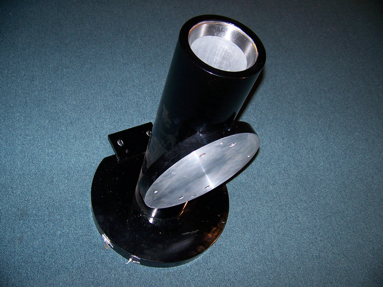 "Here's the housing that contains the Dec. shaft. The design here is flawed in theory. It uses two taper roller bearings at each end of the shaft. That is good. The bad is the bearings are the same size. So if the bearings are the same size they can not be press fitted on the shaft for assembly purposes. Therefore there must be some play between the bearings and shaft - THAT IS BAD!  If the front bearing would have been made smaller the bearing race could then be reversed and the entire shaft with bearings"" pressed fitted"" in place could have slid down into the housing you see here. The results would be tight and not sloppy.  There is excessive clearances here to be a precision device."