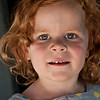 Red Head -- I don't know the name of this wonderful face. She is my 2010 mystery portrait, but I captured her at a play area in Westport in late Sept. I gave her mother my card and told her I was happy to give her the lovely photo -- I never heard from her. Anyway it is a winner in my book with lovey natural light and expression.