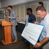 August 13, 2019 - Courtney Johnson accepts a $10,500 check on behalf of Young & Established from 100 Guys Who Care