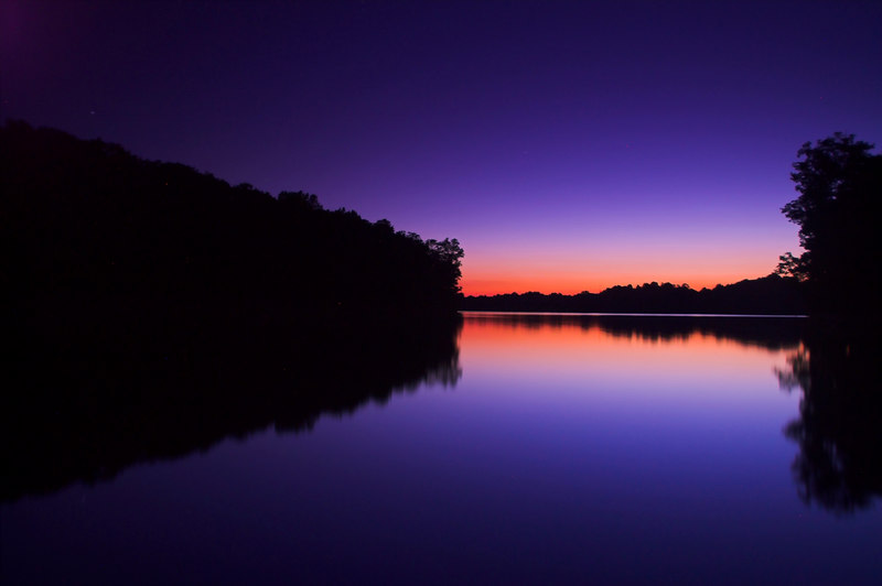Almost perfect symmetry of late sunset reflection. Shot near Black Hill lake, Maryland.