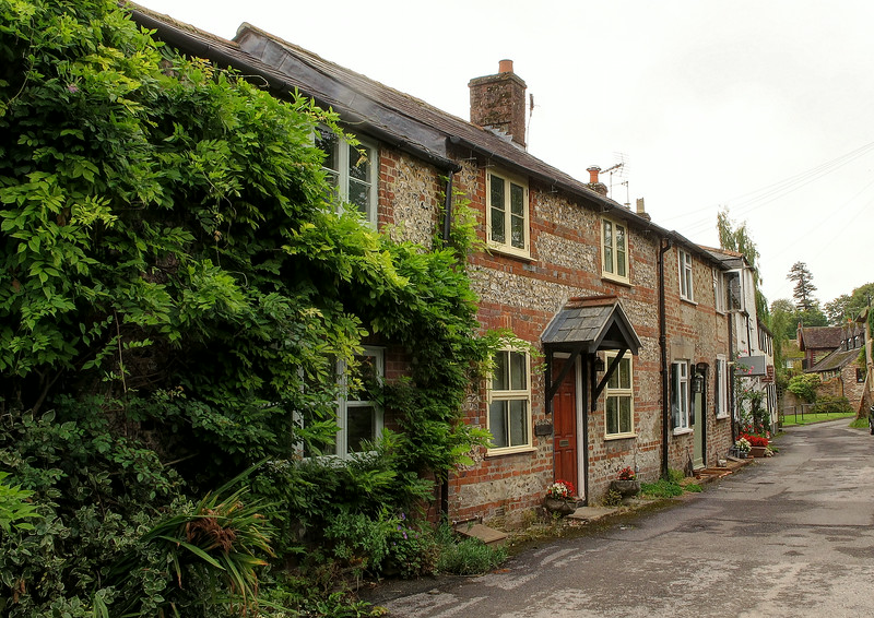 Gravel Lane in Charlton Marshall.   One of the cottages is called 'Old Inn'.