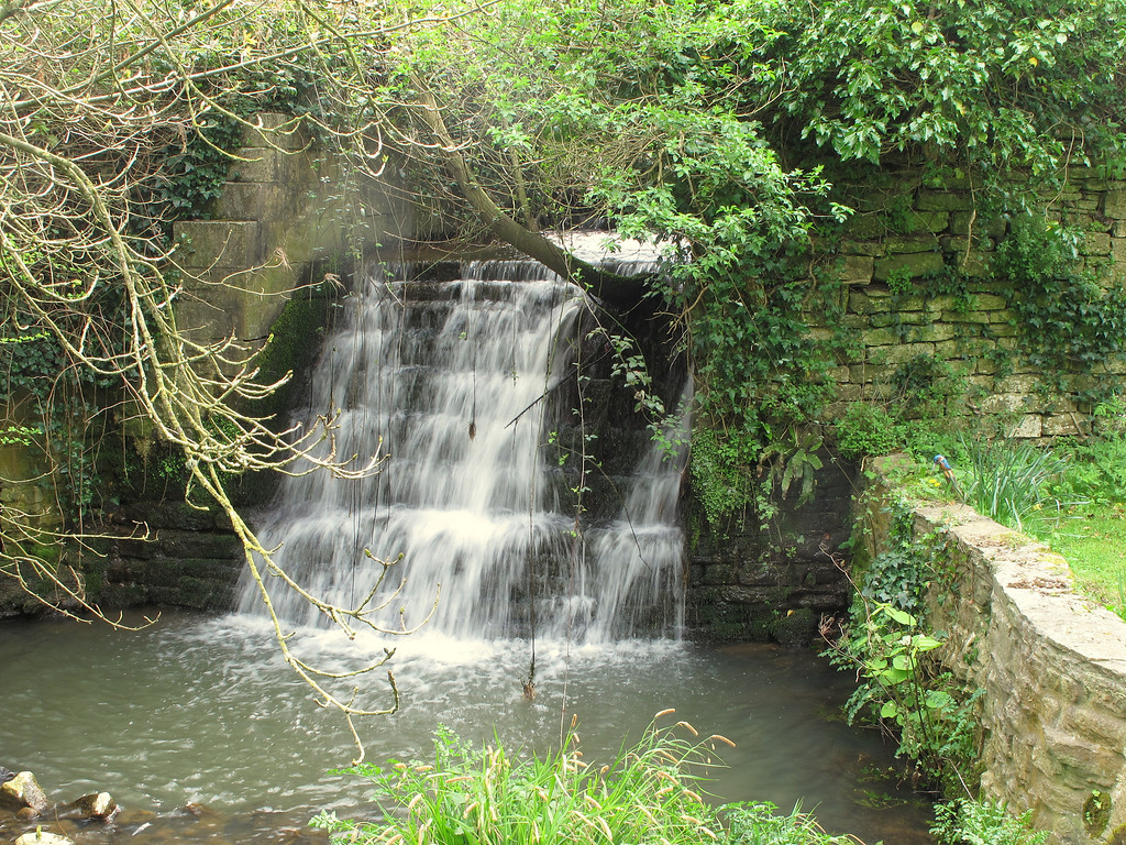 Water cascades down this waterfall adjacent to the Castle mound.