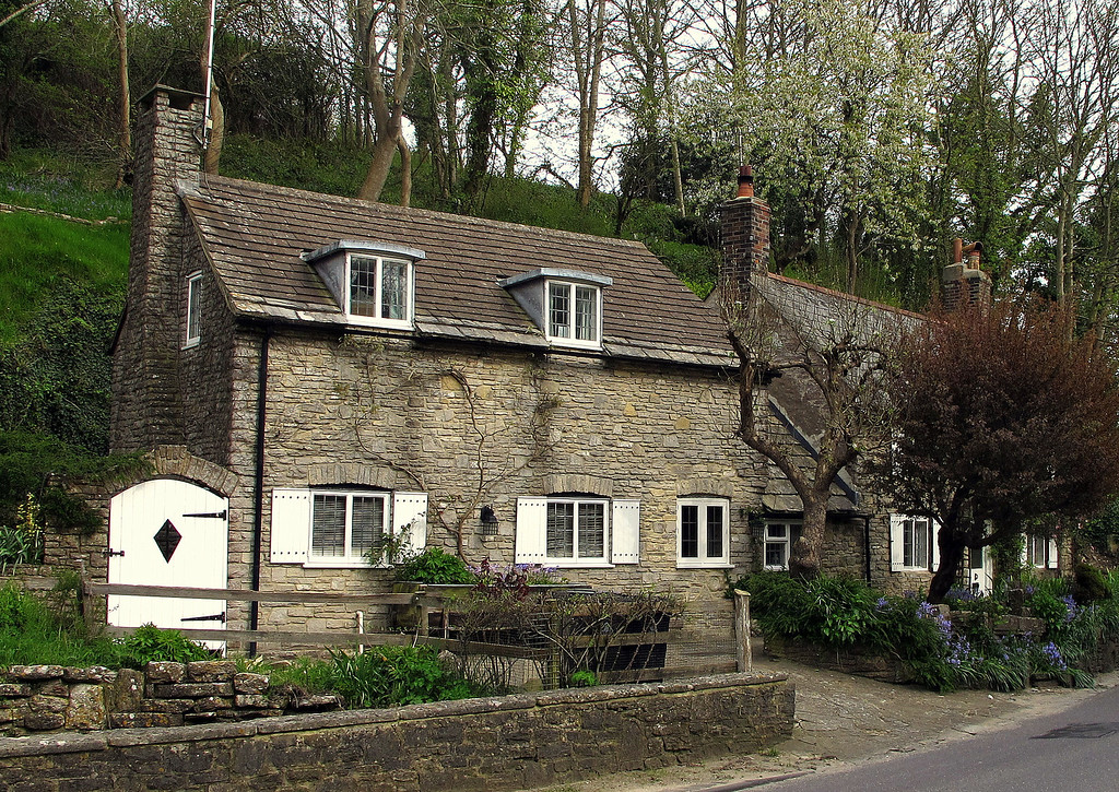 Two typical Victorian Corfe Castle cottages hard against the railway embankment.