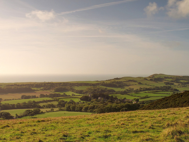 The view of Gad Cliffs from Ridgeway Hill West of Corfe Castle.   The village in the foreground is Church Knowle.